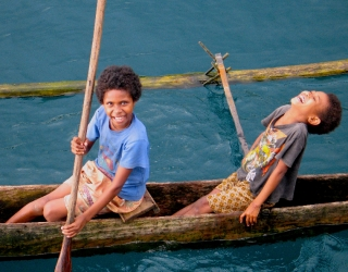 Laughing Girls in Canoe, PNG