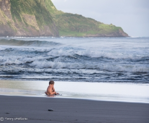 Baby on a black sand beach, Waipio, Big Island