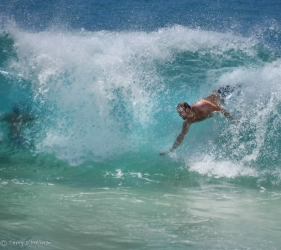 My son bodysurfing at Sandy Beach, Oahu
